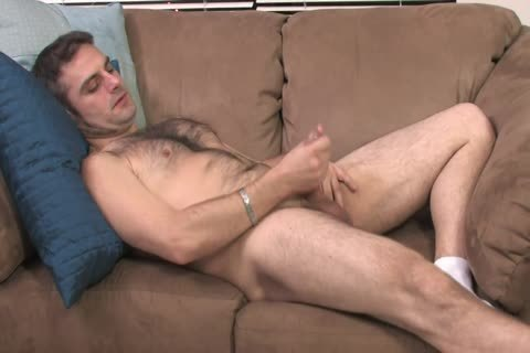 bushy stud Lays On The bed And Starts Playing With His Hard Pole