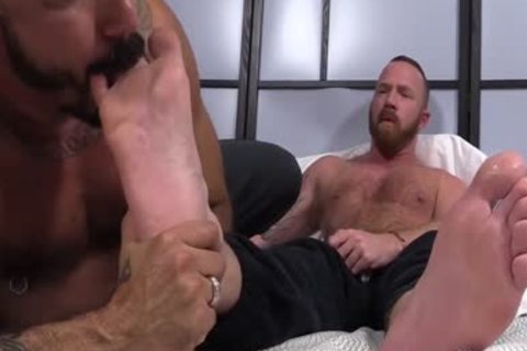 Muscled men Red And Alessio acquire lascivious As They suck Toes