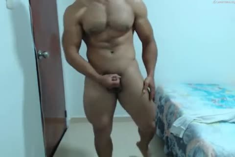 muscular Latino discharges A large Load To His yummy Abs
