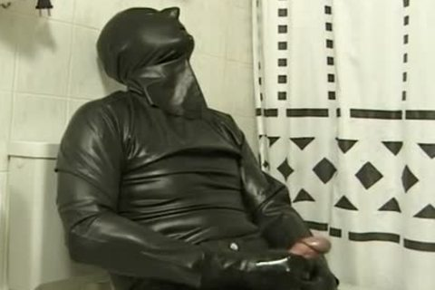 fellow In dark Latex Catsuit Jacks Off In washroomroom