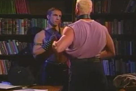 Vintage Muscled guys In Leather Stretching a-hole In Quiet Library