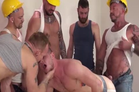 Workmen On The Job Are Taking A Break And Giving The new men Some Solid 10-Pounder In His Bum