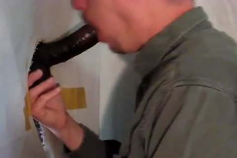 huge 8 Inch cock receives blow job stimulation  at Gloryhole