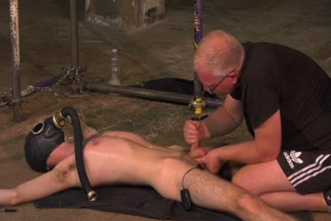 Roped Down twink gets A Gas Mask And A coarse handjob