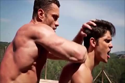 Two Muscle Hunks By The Pool